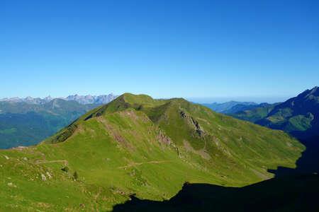 Midi d'Ossau Peak and Gentau lake on a hiking trail GR10, Pyrenees