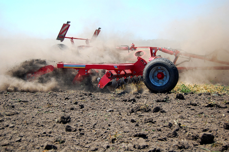harrow: Harrow is tilling soil before seeding on the high speed
