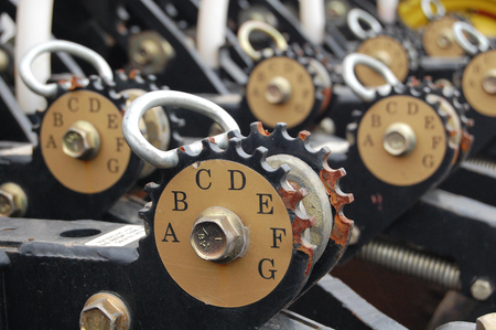 regulating: The gears use for regulating the number of seed that need for one hectare (acre) Stock Photo