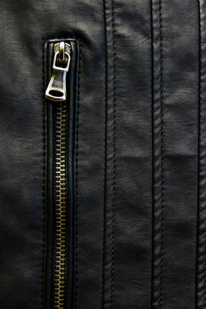 Close up of black leather jacket photo