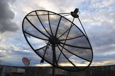 parabolic: Satellite dish with blue sky. Stock Photo