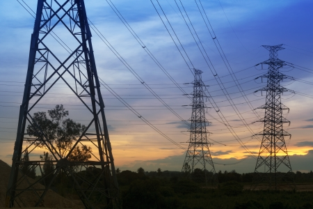 electric utility: Electrical transmission tower with sunset background.