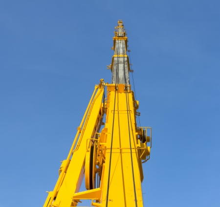 car hoist: Boom of mobile crane with blue sky background