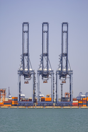 Crane at port with blue sky background.