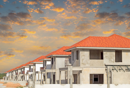 home builder: Construction of housing with sky background.