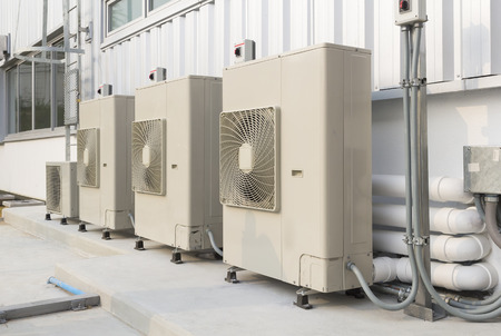 cooling system: Air compressor installation on pedestal. Stock Photo