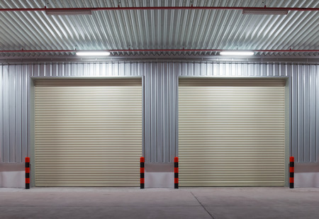 Shutter door outside factory, night scene. photo