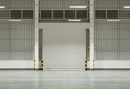 rolling garage door: Interior of factory with shutter door, night time.