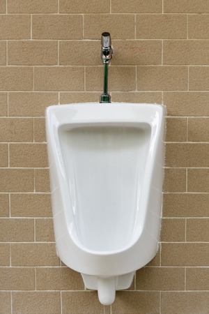 White urinals install on wall. photo