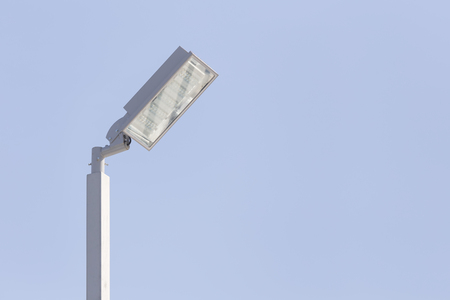 lamp on the pole: Street lamp with sky background.