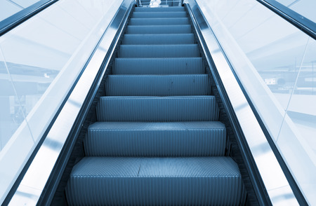 up stair: Escalator blue color tone. Stock Photo