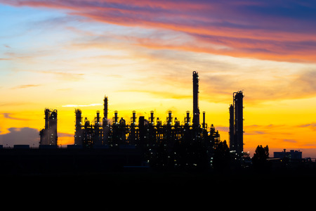 Silhouette of power plant with sunset background  photo