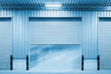 shutter door: Shutter door outside factory blue color tone.
