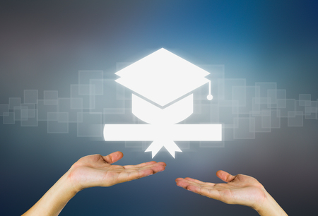 graduation cap and diploma: Concept of graduation in dark background.