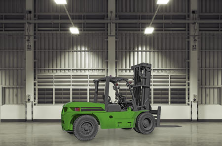 Forklift truck on concrete floor with factory background. photo