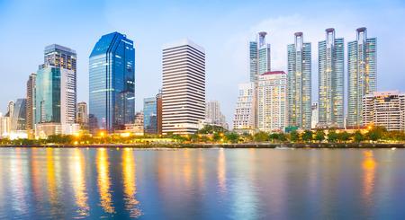 Panorama of bangkok city reflect in river. photo
