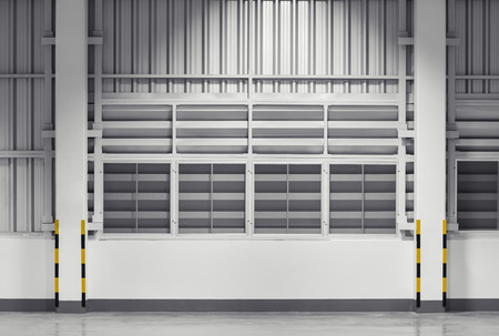 louver: Siding sheet and louver use for wall of factory, nighttime.