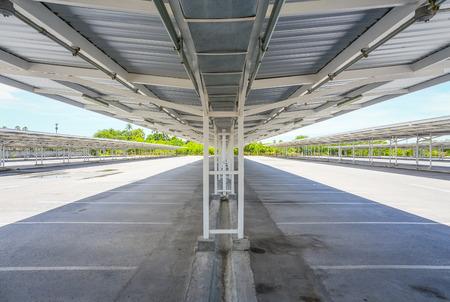 carpark: Empty car park with roof truss and asphalt floor  Stock Photo