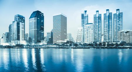 Bangkok city reflect in river, blue color tone  photo