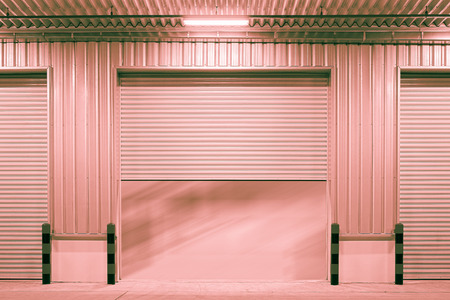 Shutter door outside factory red color tone. photo