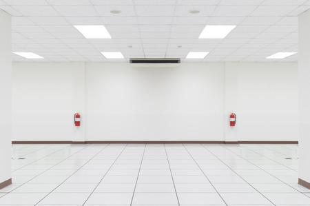 White empty room with tile floor.