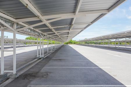 prefabricated: Empty car park with roof truss and asphalt floor.
