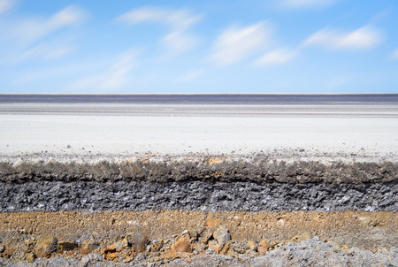Cross section of asphalt road with blue sky background. photo