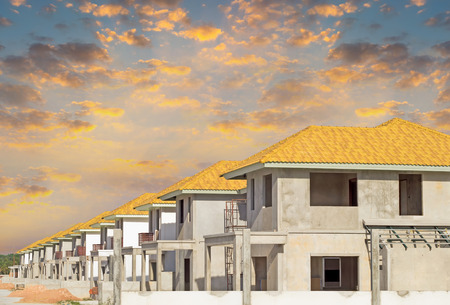 housing sales: Construction of housing with sky background.