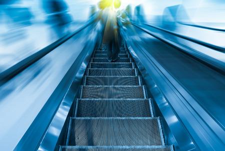 Escalator blue color tone. photo