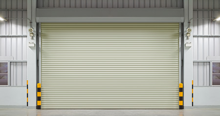 garage door: Shutter door or rolling door, night scene.