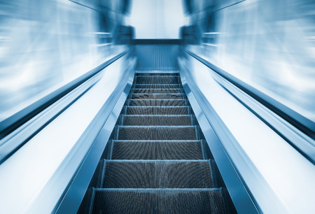 metal handrail: Escalator machine, blue color tone. Stock Photo