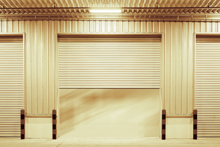 rolling garage door: Shutter door outside factory gold color tone.