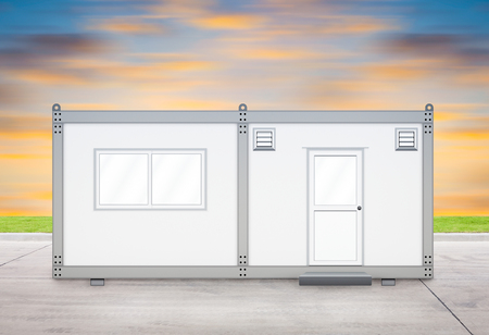 modular home: Gray container with sky background. Stock Photo