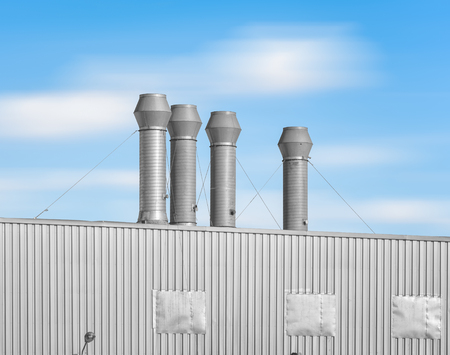 venting: Ventilation system of factory with blue sky background.