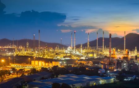 smoke stack: Oil refinery at twilight with sky background.
