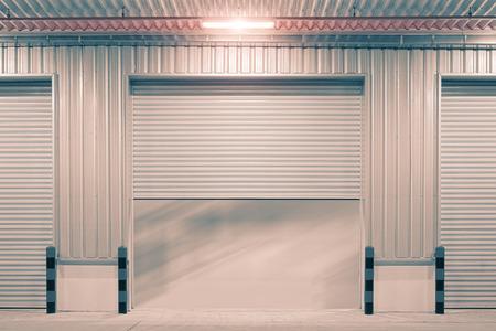 Shutter door outside factory, night scene photo