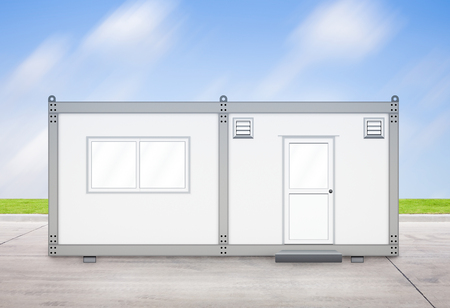 prefabricated: Gray container with sky background. Stock Photo
