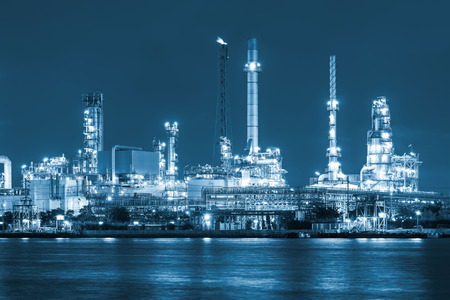 Oil refinery at twilight, blue color tone. photo