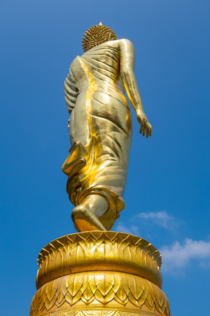 buddhist structures: Big buddha image in Wat phra that khao noi with blue sky background. Stock Photo