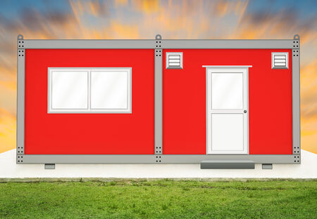movable: Red container house on concrete pedestal with sky background.
