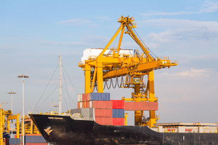 Cargo ship working with crane at port. photo