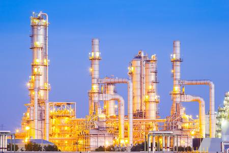 plant oil: Distillation tank of oil refinery plant, twilight time. Stock Photo