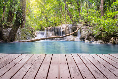 Scenery of Waterfall with wood deck. photo