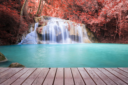 Scenery of waterfall, red leaf and blue water. photo
