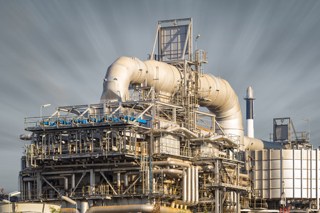 globalwarming: Machinery in oil refinery with sky background.