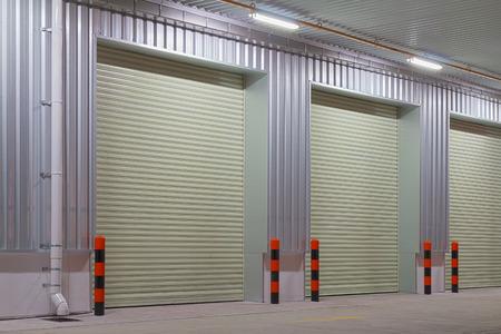Shutter door outside factory, night time.