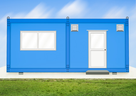 modular home: Blue container house with sky background.