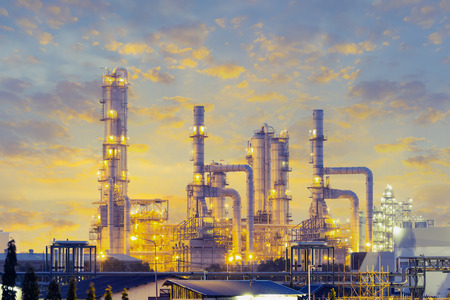 Manufacturing plant: Distillation tank of oil refinery plant, twilight time. Stock Photo