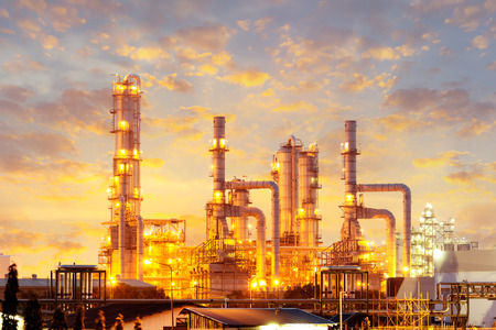 pipelines: Distillation tank of oil refinery plant, twilight time. Stock Photo