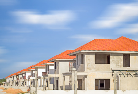 house roof: Construction site of home with sky background.